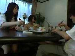 oriental footjob beneath the table