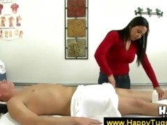 beautiful oriental masseuse works on a guys body