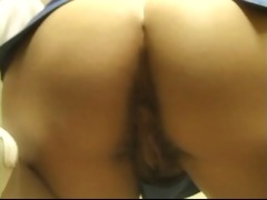 oriental bitch takes off her garments and widens