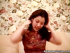 oriental sweetie undresses and fingers