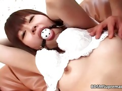 young oriental slut has ball in her face hole