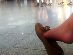 candid oriental beauty dangle at the airport