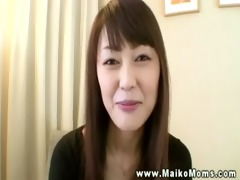 oriental business lady lets boss rub her