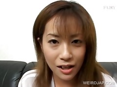 redhead oriental floozy eating a jizzed meal in