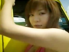 huge-boobed oriental girl shows off her goods