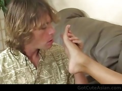 cute oriental sweetheart acquires her feet licked