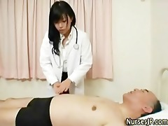 hawt oriental nurse observes patients erection