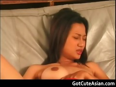 thai sweetheart putting a large sex tool in her