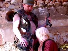 an arab woman acquires a torment by a soldier
