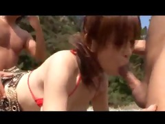 japanese three-some on the beach