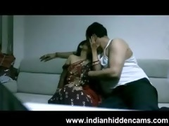 older indian pair in lounge after party seducing