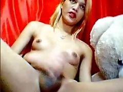 oriental shemale plays with her wet cock on