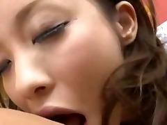 youthful oriental maid giving blowjob getting her