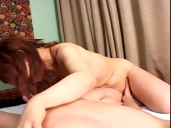 lengthy haired oriental fingers her smooth cunt