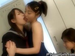 japanese schoolgirls giving a kiss and tongue