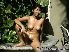 bare oriental girl drills her slit