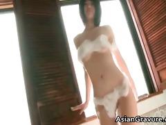 cute oriental with great body taking a washroom