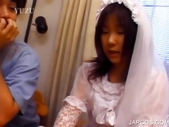 oriental in bride dress touching her body