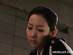 ribald oriental police hotties rubbing a convicts